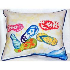 Each one of these fun, flip flop beach house indoor-outdoor pillows is a miniature work of coastal art on a durable, fade resistant fabric beach cottage pillow.