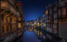Watching the Canal - Another great viewpoint over one of the canals in the old part of my hometown Dordrecht. I took this shot some weeks ago during a nice calm evening. This image was made out of 2 exposures, one of the canal and the houses and one of the sky. They were blended together for the final result.