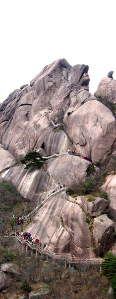 Huang Shan  Not a single step on dirt -- miles and miles of trails constructed entirely out of concrete and quarried stone. With so many visitors and with such a long history, it is the only viable way of protecting the mountain from being trampled to death.