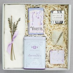 Contents - The English Garden candle by Teak & Twine with pink & silver foil label - One gold tin of lavender lip balm by The Honey Hutch - One box of shortbread cookies by Willa's wrapped in a unique
