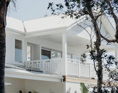 Check out this great place to stay in Shoal Bay White Exterior Paint, White Exterior Houses, House Front, My House, Investment House, Patio Fence, House Color Schemes, Hamptons House, Balcony Design