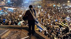 Fans in Montevideo celebrate Uruguay's shootout win over Ghana in the 2010 World Cup