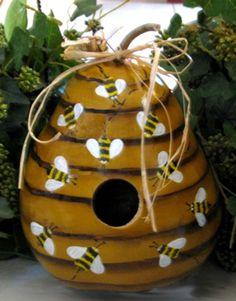 birdhouse pictures | This gourd birdhouse is shaped like and painted to resemble a beehive ...