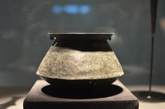 Cone-shaped Bucket, Pompeii, Bronze, 1st Cent C.E.  Buckets like this were used in the kitchen to dilute wine with water. It was then poured into a pitcjer and carried into the triclinium where it was served to diners. Romans considered it vulgar to drink wine undiluted or directly out of its container.