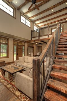 Barndominium staircase with L-shaped sofa