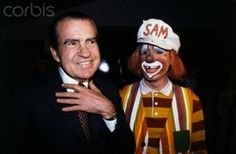 Former President Richard Nixon and Ringling Brothers clown Sam Drummond trade smiles as Nixon attended the circus with his grandchildren. (Rutherford, NJ: November 27, 1982)