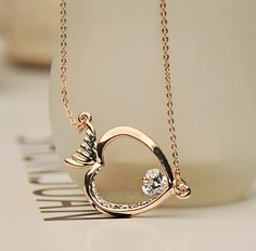 Diamond Eyed Fish Necklace | LilyFair Jewelry. Its so pretty!! Would love if someone gifts this to me!