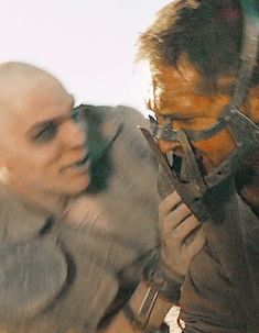Tom Hardy and Nicholas Hoult - Mad Max Fury Road    this movie was weird but i loved nicholas hoult so mucchhhhhh!