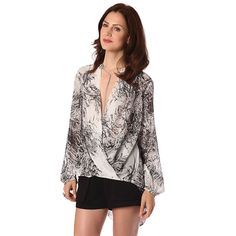 Now available on our store: White drape wrap ... Check it out here! http://coco-glam-boutique.myshopify.com/products/white-drape-wrap-blouse-in-abstract-print-and-asymmetric-hem