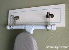 make you own ironing board wall hanger for $10 or less