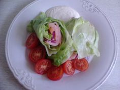 Lettuce wrap with smoked salmon, bacon, cucumber, red onions, mayo-mustard dressing and tomatoes on the side.