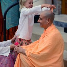Photos taken During Radhanath Swami's visit to New Dwarka, USA. Photos of his visiting the New Dwarka Temple and meeting various devotees.