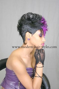 Cut and styled Mohawk pixie with accents of purple. You styling options would be 1. Custom cut style and color your own hair. 2. install a 27 piece weave. 3. custom cut and color a human hair wig.