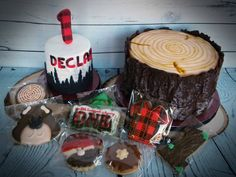 Lumberjack party smash cake and tree trunk cake.  Lumberjack cookies by Madri's Cookie Kitchen