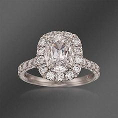 Henri Daussi Certified Diamond Engagement Ring in Platinum. This treasure - a sensational certified halo-styled 2.96 ct. t.w. diamond engagement ring - sparkles! It showcases a certified cushion-cut center diamond of 1.66 carats in a halo of 1.30 ct. t.w. of diamond rounds which flicker along the band. >>Click on the Halo Diamond Ring to shop the Ross-Simons collection.
