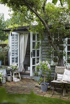 Traditional wooden cladding in a subtle blue-grey brings rustic charm to this pretty garden studio, which serves as an extra room. These really are the dream. From Country Living UK Design Jardin, Garden Design, Landscape Design, Garden Cottage, Home And Garden, The Garden Room, Outdoor Garden Rooms, Summer House Garden, Garden Cafe