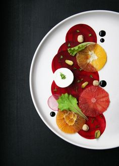 A lovely Beet Carpaccio Salad with orange, goat cheese and balsamic vinegar reduction!  http://feistyveggies.com/beet-carpaccio-salad/