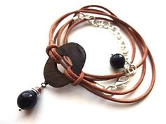 Leather Bracelet Wrap Bracelet Natural Leather bracelet hippie bracelet leather and chain bracelet adjustable bracelet layered bracelet  This wrap bracelet was made using natural not dyed leather, with a mother of pearl center piece, accompanied with obsidian beads and a silver plated chain which gives you possibility to adjust bracelets length. It will look nice with jeans and romantic tunics creating that hippie flavored look.  Please visit my eshop ~ Miela ~ (Lovely) for more jewelry…