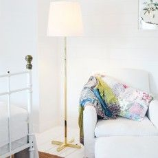 Simple classical floor lamp with a brass leg and white canvas shade. // Cross - Sessak