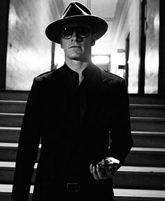 Michael Fassbender as Magneto.  Love that damn fedora, suit, and the glasses...wow...pulls it off well.