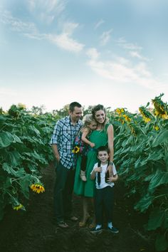 Family photo in a sunflower field