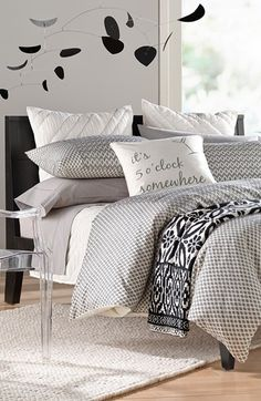 Gorgeous mix of patterns! Love the cheeky statement pillow.