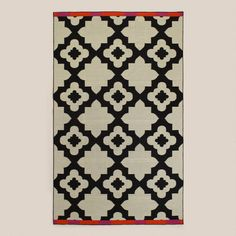 One of my favorite discoveries at WorldMarket.com: Pink-Orange Bordered Flat-Woven Indoor-Outdoor Rugs