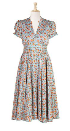 This dress has a whimsical castles & flowers print that is very reminiscent of Anthro fabrics. Plus the color combo, blue & rust, is one of my favorites. $89.95