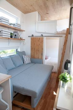 The Acacia is a modern tiny house built by Quebec-based Minimaliste. A main floor bedroom, loft bedroom, and sofa bed provide plenty of sleeping options. Interior, Home, Small Room Design, Bedroom Loft, House Interior, Tiny House Bedroom, Interior Design, Home And Living, Little Houses