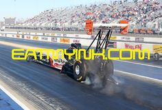 Clay Millican strikes the tires at the 2015 4wide at zMAX #NHRA on http://eatmyink.com/ Millican_Torrence_NHRA4wide15_6716cropSH
