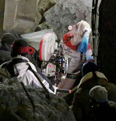 Margot Robbie as Harley Quinn blowing a bubble behind the scenes of Suicide Squad