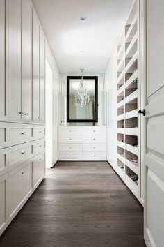 Walking into a long walk in closet you'll see a white dresser with a black mirro. Walking into a long walk in closet you'll see a white dresser with a black mirror overhead. House, Home, Built Ins, Walk In Closet Design, White Dresser, Closet Designs, Closet Decor, Dressing Room Design