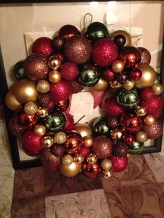 Christmas ornament wreath. foam wreath and a crap ton of hot glue! Wrapped the wreath with a tinsel strand to help fill in some gaps -mg