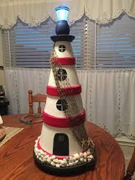 Clay Pot Lighthouse – made using five clay pots and two clay saucers. Lighthouse Lighting For this, you can use virtually anything. Clay Pot Projects, Clay Pot Crafts, Diy Clay, Crafts To Make, Fun Crafts, Shell Crafts, Flower Pot Art, Flower Pot Crafts, Flower Pots