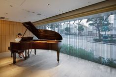 The design of this piano shop in Tokyo by local architecture studio Salt is intended to reflect the craftsmanship of the instruments on sale inside
