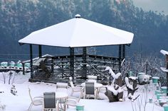 Machaan (an outdoor sitting area) offering stunning views of the Himalayas is often covered with powdered snow during the winters