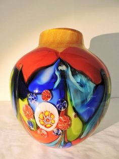Dino Ripa, Murano - vase 'Sarrezo' . 21st century, Italy Glass art vases by Dino Ripa is unique art. Each glass vase is formed on the basis of traditional handicraft art glass techniques. Beautifully thick-walled blown vase in bright colors and stylized flower shapes. Height: 24 centimeters. Weight: approx 3250 grams. Comes with Certificate of Authenticity, condition: excellent  Price : 950 euros