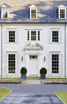 My personal aesthetic is what I often describe as a modern take on traditional style. I love homes that feel classic and are anchored by traditional architecture or furnishings, but. Colonial House Exteriors, Colonial Exterior, Modern Colonial, Modern Farmhouse Exterior, Traditional Exterior, Traditional House, Exterior Design, Exterior Paint, White Shutters