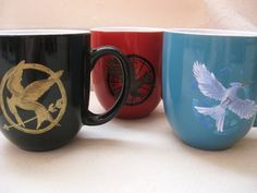 Holy mother of all things I love, Hunger Games coffee mugs.