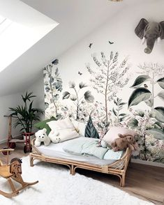 Today we are sharing 10 Stylish Nursery Wallpaper Ideas that just might convince to wallpaper your baby's nursery.