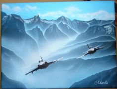 Painted planes in mountains