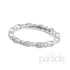 from Parade Design An eternity band of round diamonds set in marquise shapes is a perfect complement to any stackable band