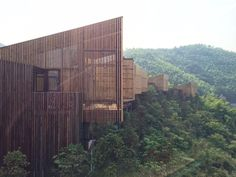 Tree top houses an a sloped hill of a bamboo forest nearby Liyang, China.  Design by AchterboschZantman architects, the Netherlands.