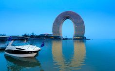 Sheraton Huzhou Hot Spring Resort, Huzhou, China  Nicknamed the 'doughnut hotel', the Sheraton Huzhou Hot Spring Resort is on the Taihu Lake inbetween Nanjing and Shanghai. The magnet-shaped hotel was conceived by architect Ma Tansong, who has worked with Zaha Hadid in London and is responsible for the rippling Absolute Towers in Mississauga, Canada. The 27 floors above water, and two below (to create a complete oval) feature luxury trimmings, including a lobby paved with White Jade from…