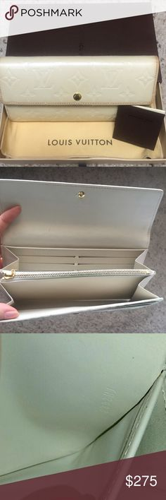 Authentic LV wallet Authentic LV wallet. Care card, Dustbag and box included. Gently used. Please see all the pictures in my closet :D Retail $980. Louis Vuitton Bags Wallets
