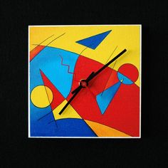 Fun abstract art clock with intense yellows reds and by indyRtist