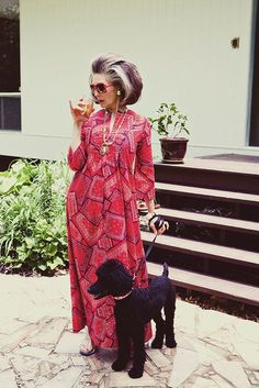 I want to look like this when I am old..a drink in one hand and a poodle on leash in the other. ha