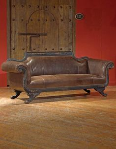 "DUNCAN PHYFE LEATHER SOFA;With its empire design and distinctively Edwardian romance, this claw footed couch is upholstered in buttery leather in a marriage of casual and upscale design suited for any decor. Hand carved wood. Brass studs. 35 x 84 x 33""."