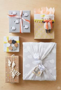 If you're headed to a baby shower, try these gift wrap ideas to really make your gift memorable. With a little DIY magic and a sweet pattern, you can perfectly wrap a baby shower gift! 5 Gift Wrap Ideas: Add a lamb to a bag Tie a heart-covered blanket ar Baby Gift Wrapping, Gift Wraping, Creative Gift Wrapping, Christmas Gift Wrapping, Creative Gifts, Baby Shower Wrapping, Diy Baby Gift Wrap, Birthday Wrapping Ideas, Unique Gifts