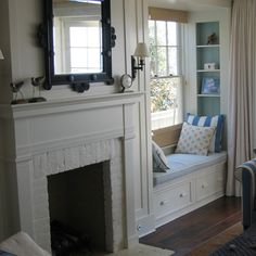 Window seat tucked in next to the fireplace, built-in shelves, curtain.In Good Taste: Giannetti Home, nook Fireplace Windows, Fireplace Built Ins, Living Room With Fireplace, Fireplace Mantels, My Living Room, Mantle, Fireplace Bookcase, Craftsman Fireplace, Brick Fireplaces